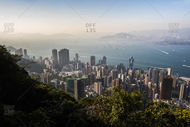 March 10, 2018: View over Victoria Harbour at sunset, seen from Victoria Peak, Hong Kong Island, Hong Kong, China, Asia