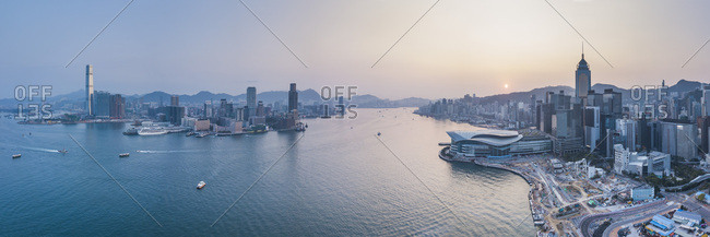March 12, 2018: View over Victoria Harbour and Hong Kong at sunset, China, Asia
