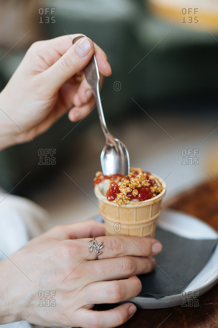 Woman scooping cobbler crumble ice cream cone