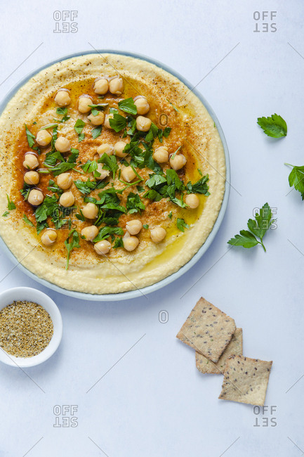 Plate of hummus with crackers