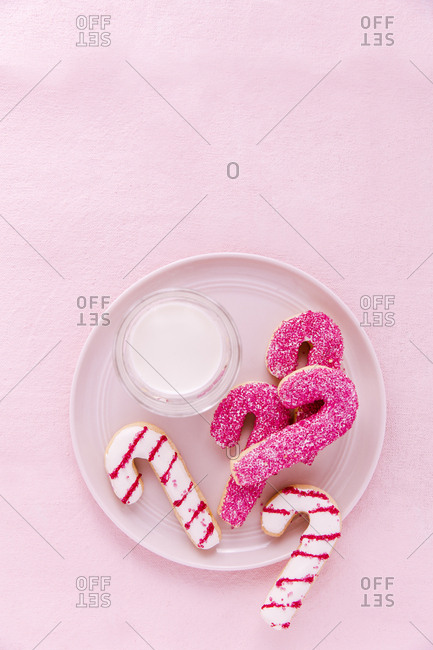Candy cane cookies on pink background