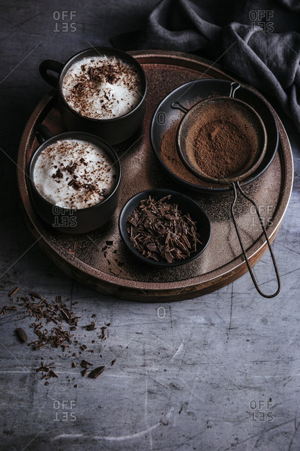 Two hot chocolates with milk foam and chocolate