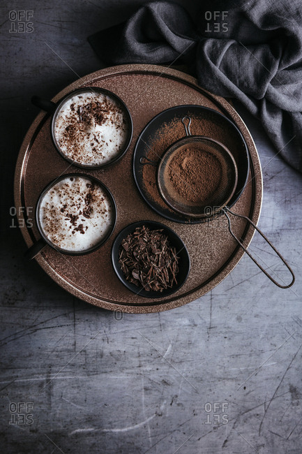 Two hot chocolates with milk foam on a tray-overhead shot