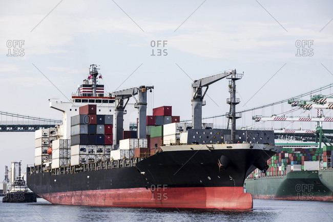 Los Angeles, California, USA - July 18, 2018: Large container ships docked in metropolitan port