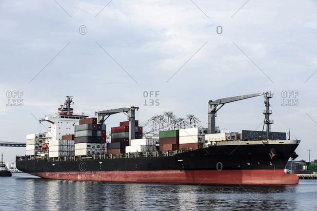 Los Angeles, California, USA - July 18, 2018: Ship loaded with cargo containers at metropolitan port