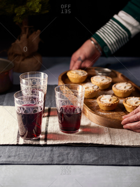 Woman serving Christmas mince pies