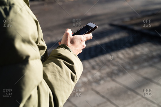 Close up of a man using his smartphone