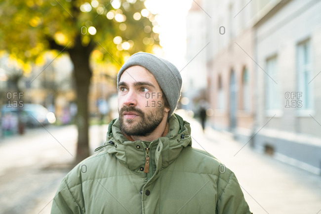 Portrait of a bearded man wearing a knit hat and a jacket