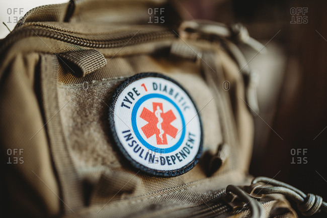 Detail of backpack with diabetes patch