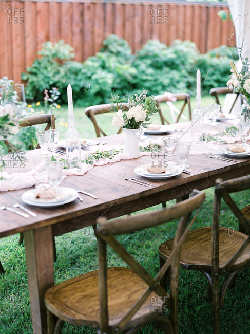 Wooden table at an outdoor wedding