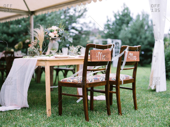 Mr. and Mrs. chairs at an outdoor wedding