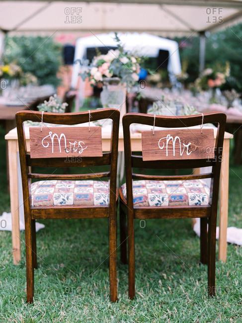 Bride and groom chairs at an outdoor wedding