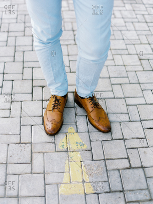 Groom wearing blue slacks and tan oxford loafers