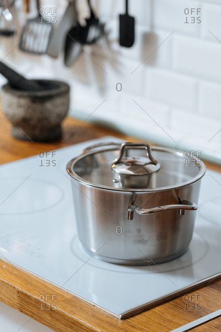 Stainless steel pot on kitchen cook top