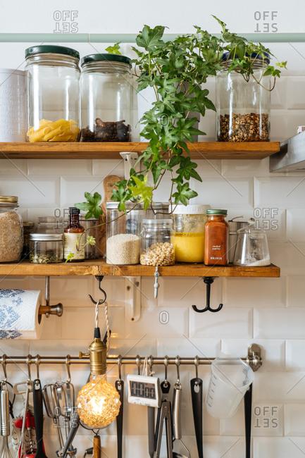 Jars on wooden kitchen shelves stock photo - OFFSET