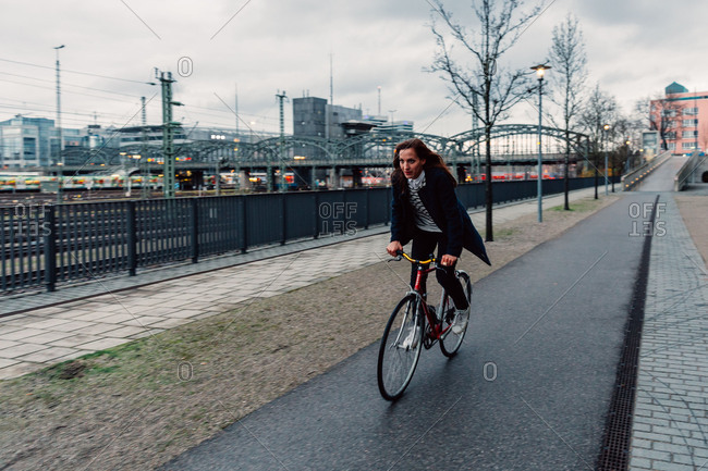 Woman with bicycle in the town