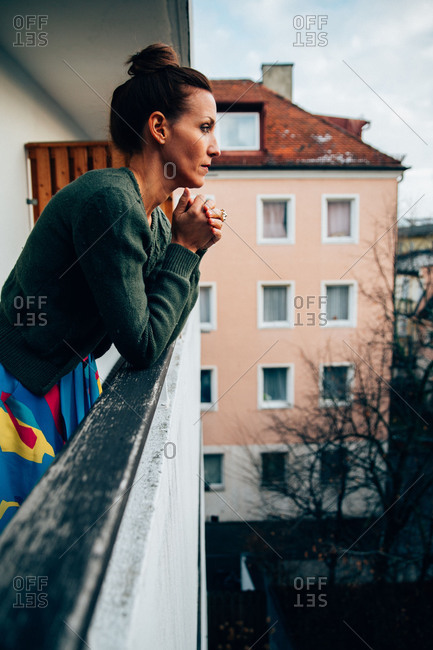 Pensive woman on balcony