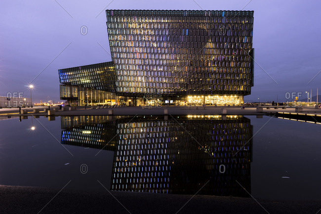 Europe, Northern Europe, Iceland, Reykjavik, Harpa Concert Hall, Evening view to the illuminated Harpa Concert Hall in the harbor