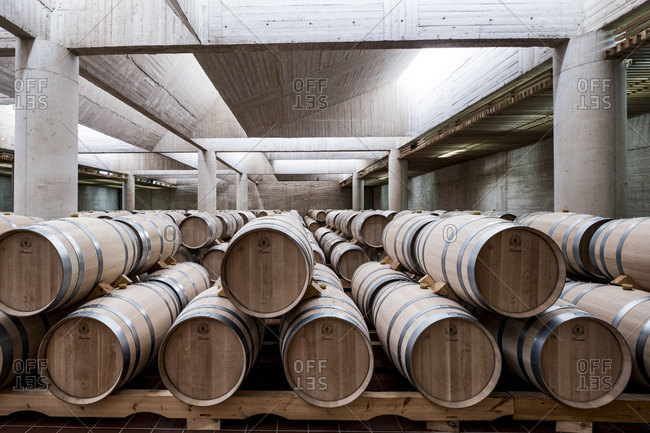 Barrels in the modern facilities of Pago de Carraovejas wine cellars of Ribera del Duero denomination of origin in Valladolid Spain Europe