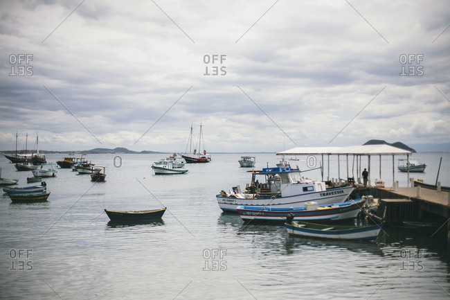 boats close to the beach and a pier in brazil