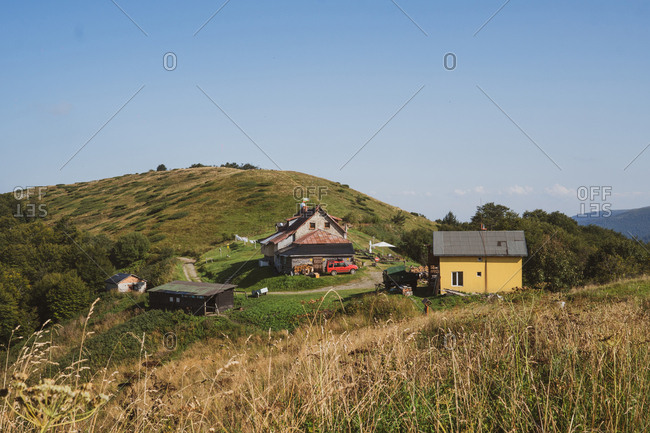 Magnificent view of lovely cottages standing on top of hill on beautiful sunny day in Bulgaria, Balkans
