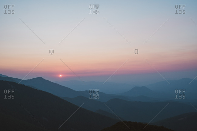 Magnificent view of beautiful sunset sky over majestic hills in Bulgaria, Balkans
