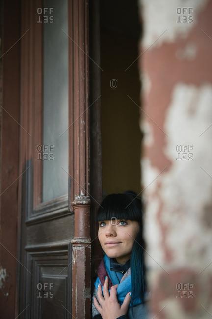 Woman from the door looking away