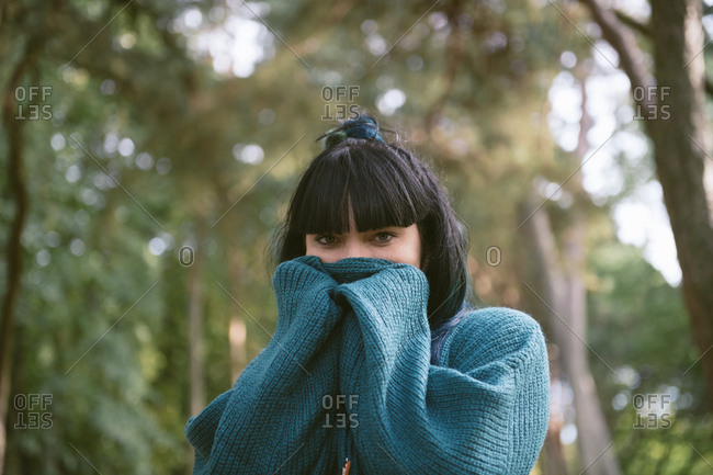 Beautiful dreamy woman in sweater outdoors
