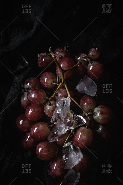 Fresh red grapes in season. Flat lay. Top view On dark background