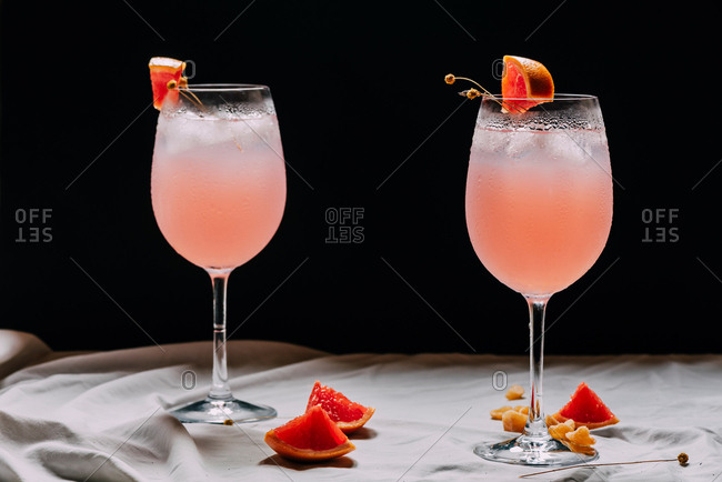 Cocktail grapefruit. Alcoholic beverage with tropical fruits lavender and ice flowers