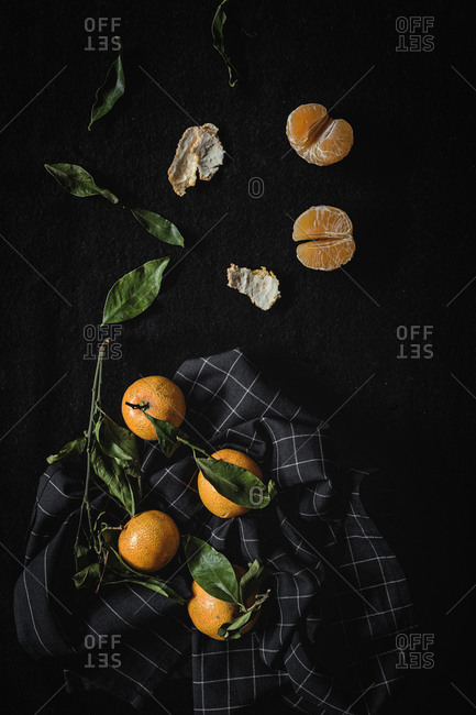 Fresh tangerines in season. Flat lay. Top view On dark background