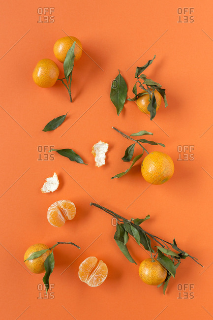 Fresh tangerines in season. Flat lay. Top view On orange background