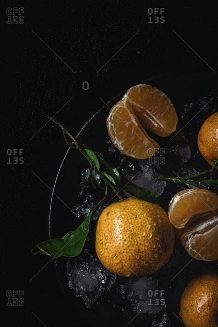 Fresh tangerines in season. Flat lay. Top view On dark background