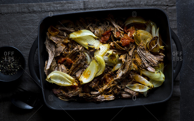 Pot roast with onions in a baking pan