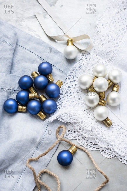 Close up of white and blue vintage glass bulbs with strings