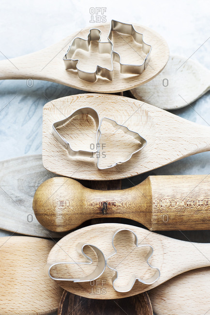 Close up of wooden spoons with Christmas cookie cutters
