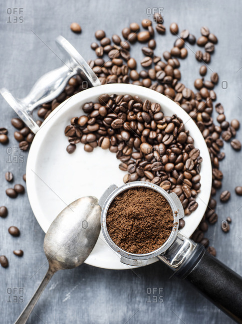 Coffee beans and a portion of ground coffee