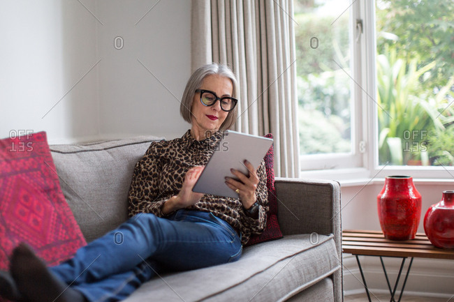 Mature adult female using a digital tablet