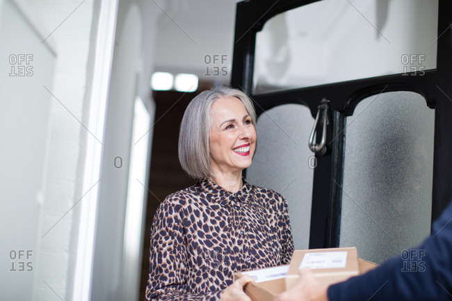 Mature woman receiving a home delivery