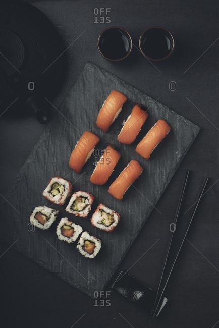 Sushi set on black slate from above