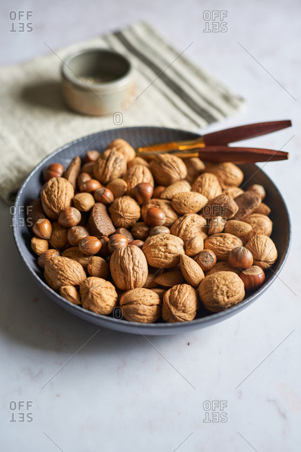 Bowl of nuts on table