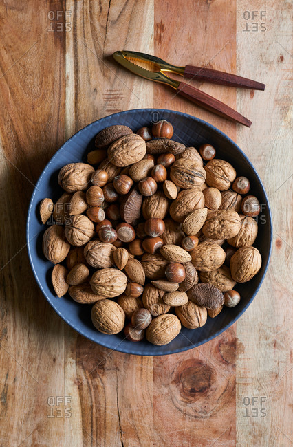 Bowl of nuts on wooden background