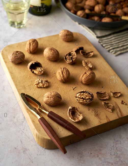 Cracked walnuts on wood board