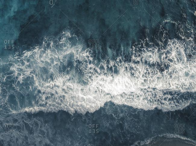 Bird's eye view of waves splashing in the ocean