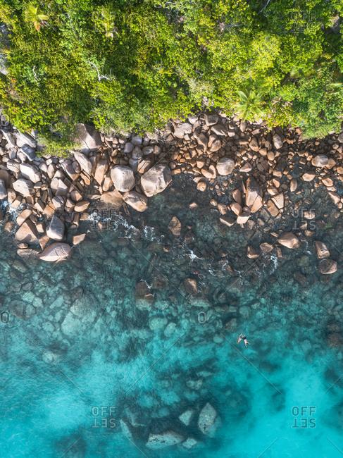 Bird's eye view of rocky coastline on Seychelles, Africa