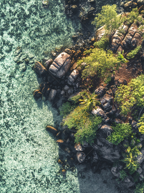 Ocean and rocky coastline of Seychelles, Africa from above
