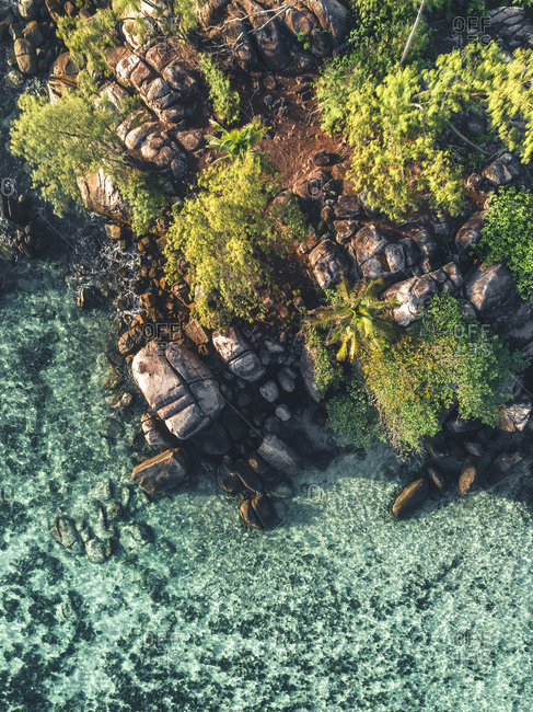 Bird's eye view of ocean and rocky coastline of Seychelles, Africa