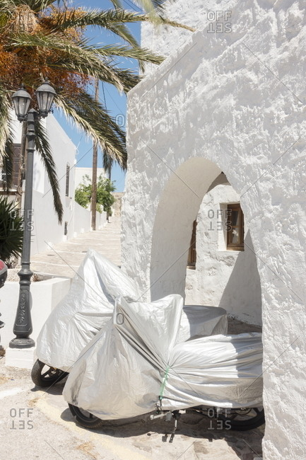 Two covered motorcycles, Trypiti, Milos, Cyclades, Greece