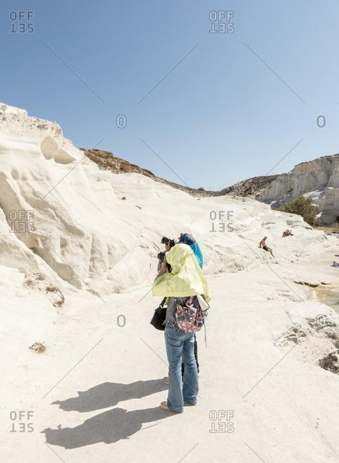 Milos, Cyclades, Greece - July 21, 2018: Tourists on Sarakiniko beach