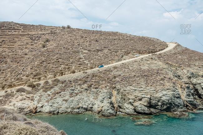 Cars on winding road, Agios Georgios Beach, Folegrandos, Cyclades, Greece